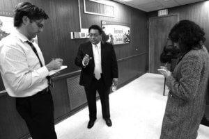 San Antonio Express-News Reporters John Tedesco and Maria Luisa Cesar interviewing Manuel Isquierdo