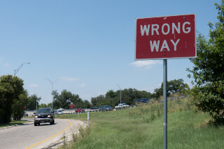 Wrong way sign on exit ramp